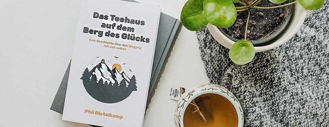 Das Teehaus auf dem Berg des Gluecks Phil Distelkamp Buch Rezension Beitragsbild